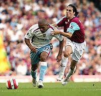 Photo: Chris Ratcliffe.<br /> West Ham United v Aston Villa. The Barclays Premiership. 10/09/2006.<br /> Luke Moore of Aston Villa clashes with Yossi Benayoun of West Ham.