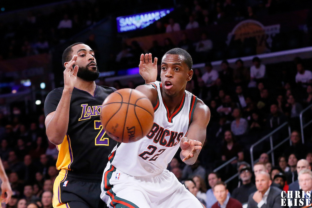 27 February 2015: Milwaukee Bucks guard Khris Middleton (22) passes the ball past Los Angeles Lakers guard Wayne Ellington (2) during the Los Angeles Lakers 101-93 victory over the Milwaukee Bucks, at the Staples Center, Los Angeles, California, USA.