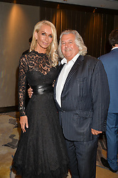 ANDREW & KIM PERLOFF at a party to celebrate Jack Petchey's 90th birthday in association with the Stroke Association held at the Shangri-La Hotel, Level 34, The Shard, London on 13th July 2015.