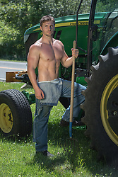 hot sexy farmer without a shirt by a tractor