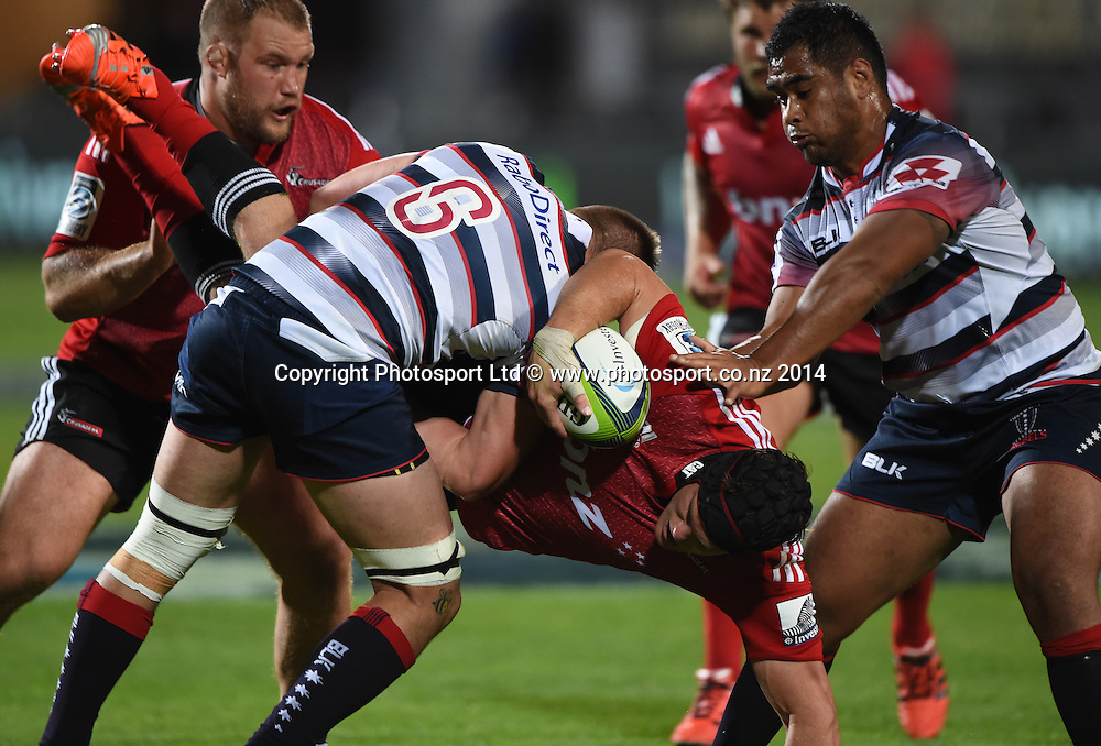 Matt Todd tackled by Sean McMahon. Crusaders v Rebels. Super Rugby. Christchurch, New Zealand. Friday 13 February 2015. Copyright Photo: Andrew Cornaga / www.photosport.co.nz