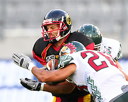 08.07.2011, Tivoli Stadion, Innsbruck, AUT, American Football WM 2011, Group A, Germany (GER) vs Mexico (MEX), im Bild Pascal Maier (Germany, #6, WR) get hard tackles from López Rassiel gregorio (Mexico, #28, FS) and Montembruck Alberto (Mexico, #15, LB)  // during the American Football World Championship 2011 Group A game, Germany vs Mexico, at Tivoli Stadion, Innsbruck, 2011-07-08, EXPA Pictures © 2011, PhotoCredit: EXPA/ T. Haumer