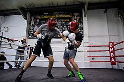 © London News Pictures. 29/12/2016. Two-weight world boxing champion, Carl Frampton (right), nickname The Jackal, sparring at his gym in south London. Frampton has been named ESPN's fighter of the year. Photo credit: Ben Cawthra/LNP