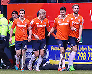 Jonathan Smith of Luton Town (2nd right) celebrates scoring his team's third goal against Cambridge United to make it 3-0 during the Sky Bet League 2 match at Kenilworth Road, Luton<br /> Picture by David Horn/Focus Images Ltd +44 7545 970036<br /> 31/01/2015