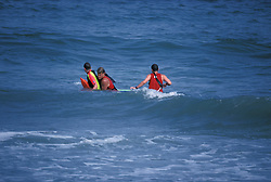 Life guard, shore patrol members practice their rescue procedures in surf on the beach in Stone Harbor, NJ.