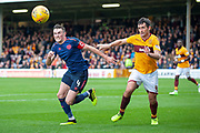 John Souttar (#4) of Heart of Midlothian and Carl McHugh (#4) of Motherwell FC complete for the ball during the Ladbrokes Scottish Premiership match between Motherwell and Heart of Midlothian at Fir Park, Motherwell, Scotland on 15 September 2018.