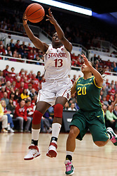 February 26, 2011; Stanford, CA, USA;  Stanford Cardinal forward Chiney Ogwumike (13) tries to control the ball past Oregon Ducks guard Ariel Thomas (20) during the first half at Maples Pavilion.