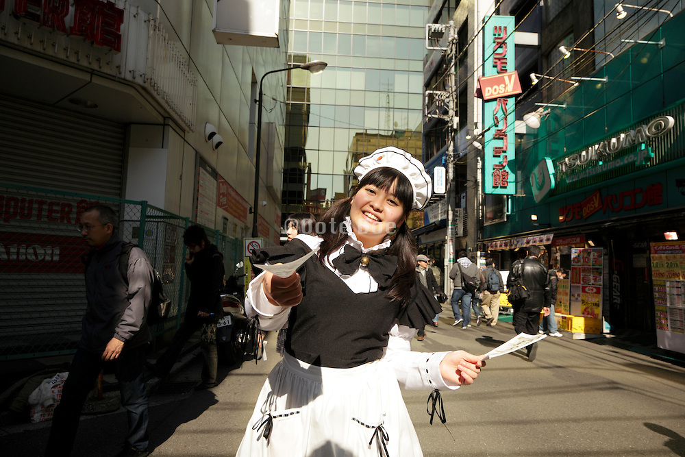 dressed up girl in Akihabara district in Tokyo handing out flyers