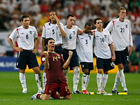 Photo: Glyn Thomas.<br />England v Portugal. Quarter Finals, FIFA World Cup 2006. 01/07/2006.<br /> England's players are dejected as Nuno Valente celebrates Portugal's victory.