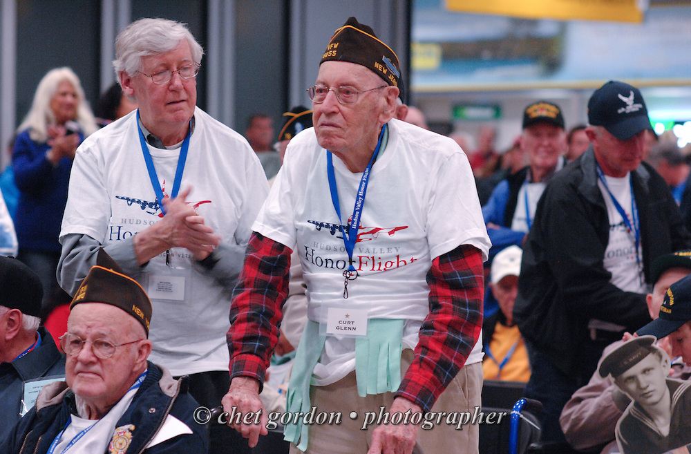 WWII Veterans and their escorts during a departure ceremony at Stewart International Airport in Newburgh, NY prior to their Hudson Valley Honor Flight to Washington, DC on Saturday, April 26, 2014. One Hundred WWII Veterans from the Hudson Valley region of New York toured the WWII Memorial in Washington, DC and Arlington National Cemetery in Arlington, VA.  © www.chetgordon.com