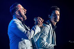 © Licensed to London News Pictures . 05/04/2014 . Manchester , UK . A J McLean singing and Kevin Richardson on keyboard . The Backstreet Boys play at the Phones4U Arena in Manchester this evening (Saturday 5th April 2014) . Photo credit : Joel Goodman/LNP