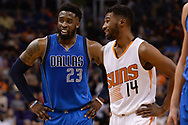 Apr 9, 2017; Phoenix, AZ, USA; Dallas Mavericks guard Wesley Matthews (23) and Phoenix Suns guard Ronnie Price (14) share a laugh on the court during the first half of the NBA game at Talking Stick Resort Arena. Mandatory Credit: Jennifer Stewart-USA TODAY Sports