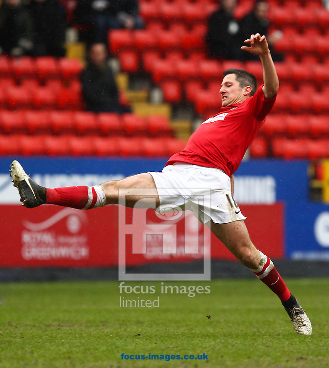 Picture by John  Rainford/Focus Images Ltd +44 7506 538356.16/03/2013.Yann Kermorgant of Charlton Athletic is at full stretch against Millwall during the npower Championship match at The Valley, London.