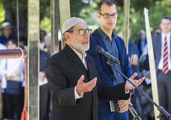 March 24, 2019 - Christchurch, Canterbury, New Zealand - Imam Ibrahim Abdul Halim of the Linwood mosque addresses a crowd at an interfaith service at the Peace Bell in the Botanic Gardens. Some 24 different faiths were represented at the service, with the Peace Bell sounding 50 times in memory of those killed at the Al Noor and Linwood mosques on 15 March. (Credit Image: © PJ Heller/ZUMA Wire)