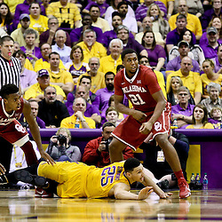 Jan 30, 2016; Baton Rouge, LA, USA; LSU Tigers forward Ben Simmons (25) loses the ball as Oklahoma Sooners forward Dante Buford (21) defends during the second half of a game at the Pete Maravich Assembly Center. Oklahoma defeated LSU 77-75. Mandatory Credit: Derick E. Hingle-USA TODAY Sports
