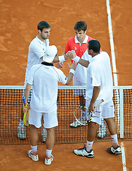 MONTE-CARLO, MONACO - Wednesday, April 14, 2010: Marcel Granollers (ESP) and Tommy Robredo (ESP) shake hands with Jo-Wilfried Tsonga (FRA) and Richard Gasquet (FRA) during the Men's Doubles 1st Round match on day three of the ATP Masters Series Monte-Carlo at the Monte-Carlo Country Club. (Photo by David Rawcliffe/Propaganda)