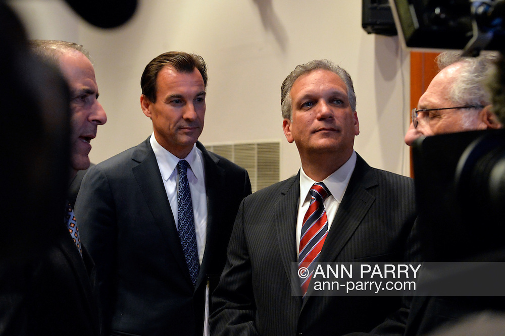 Old Westbury, New York, U.S. 8th October 2013. R-L, Republican EDWARD MANGANO, the Nassau County Executive, and Democrat THOMAS SUOZZI, the former Nassau County Executive, are approached by supporters and media before the two face each other in a debate hosted by the Nassau County Village Officials Association, representing 64 incorporated villages with 450,000 residents, as the opponents face a rematch in the 2013 November elections.