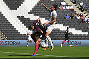 Peterborough United defender Frankie Kent (6) battles for possession  with Milton Keynes Dons defender Russell Martin (16) during the EFL Sky Bet League 1 match between Milton Keynes Dons and Peterborough United at stadium:mk, Milton Keynes, England on 24 August 2019.