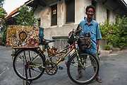 A local character collects amulets to protect his bicycle. Dusit, Bangkok.