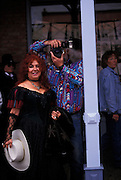 Audience member photographs event on Allen St., Helldorado Days, Tombstone, Arizona. ©Edward McCain/McCain Creative, Inc. All Rights Reserved 520-623-1998