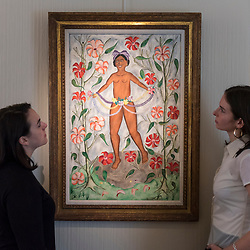 "© Licensed to London News Pictures. 02/10/2018. LONDON, UK. Staff members view ""Erzulie"", 1961, by Rigau Benoit. Preview of ""Art + Revolution in Haiti"", an exhibition at The Gallery of Everything in Chiltern Street.  The exhibition, which coincides with Frieze Week, explores when Surrealism arrived in the former slave colony in 1945.  Works from artists from le Centre d'Art d'Haiti and from the personal collection of Andre Breton, the founder of Surrealism, are on display until 11 November 2018.  Photo credit: Stephen Chung/LNP"