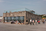 Closed after fire damage but recently re-opened, visitors on the newly-opened Hastings pier in Sussex, England.