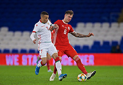 CARDIFF, WALES - Monday, September 9, 2019: Wales' Joe Rodon (R) and Belarus' Maks Ebonh Nhome Afryd during the International Friendly match between Wales and Belarus at the Cardiff City Stadium. (Pic by David Rawcliffe/Propaganda)