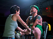 Wrestling fan Erika Morales staples money to MC Turtle's scrotum during a stunt in the St. Patrick's Day Leprechaun Smackdown by Midgets Unleashed at the Fremont Country Club on Tuesday, March, 17, 2015. L.E. Baskow