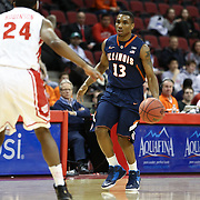 Tracy Abrams #13 of the Illinois Fighting Illini dribbles the ball during the NIT First Round game at Agganis Arena on March 19, 2014 in Boston, Massachusetts . (Photo by Elan Kawesch)