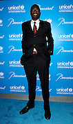 Dikembe Mutombo poses at the 2009 UNICEF Snowflake Ball Arrivals in New York City on December 2, 2009.