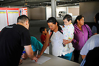 Food recipients sign in to pick up basics from a La Paz Park distribution point managed by Celebration Worship and supplied by the Food Bank of Monterey County.