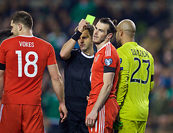 DUBLIN, REPUBLIC OF IRELAND - Friday, March 24, 2017: Wales' Gareth Bale looks dejected as Referee Nicola Rizzoli shows him a yellow card ruling him out of the next fixture, during the 2018 FIFA World Cup Qualifying Group D match against Republic of Ireland at the Aviva Stadium. (Pic by David Rawcliffe/Propaganda)