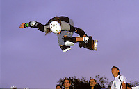 Youth on half pipe ramp at a skateboarding event  in  London.