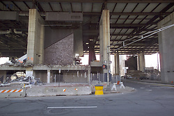 "Razing the New Haven Coliseum. Deconstruction Project as seen on 13 April 2006 from Crown Street. North Elevation showing under garage steel detail, support piers, rust and the escalators to access the parking garage above. The Garage was eventually ""Imploded"" to ground level for removal."