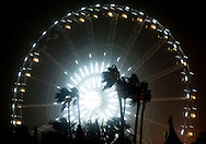 Wind-blown palm trees are silhouetted by the giant ferris wheel to close out the first weekend of the 2013 Coachella Valley Music and Arts Festival in Indio, Calif. Sunday....///ADDITIONAL INFO:   ..coachella3.0415.kjs  ---  Photo by KEVIN SULLIVAN / Orange County Register  --  4/14/13..Day 3 of the 2013 Coachella Valley Music and Arts Festival in Indio, Calif. ..4/14/13..