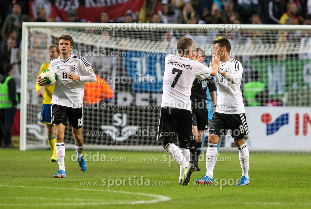 15.10.2013, Friends Arena, Stockholm, SWE, FIFA WM Qualifikation, Schweden vs Deutschland, Gruppe C, im Bild Germany 8 Mesut &Ouml;zil score 2-1,, , Nyckelord , Keywords : football , fotboll , soccer , FIFA , World Cup , Qualification , Sweden , Sverige , Schweden , Germany , Tyskland , Deutschland jubel jublande glad gl&copy;dje lycka happy happiness celebration celebrates // during the FIFA World Cup Qualifier Group C Match between Sweden and Germany at the Friends Arena, Stockholm, Sweden on 2013/10/15. EXPA Pictures &copy; 2013, PhotoCredit: EXPA/ PicAgency Skycam/ Ted Malm<br /> <br /> ***** ATTENTION - OUT OF SWE *****