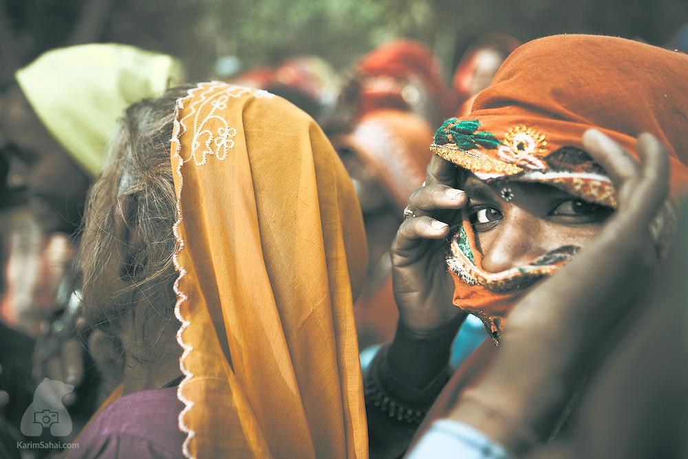 Woman looking through her veil, Sawai Madhopur, Rajasthan, India.