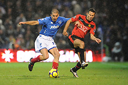 Ryan Giis attempts to make a tackle. Portsmouth v Manchester United (1-4), Barclays Premier League Fratton Park, Portsmouth, 28th November 2009.
