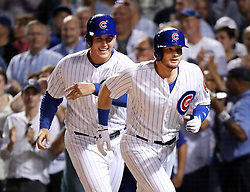 August 30, 2017 - Chicago, IL, USA - The Chicago Cubs' Ian Happ, right, with teammate Anthony Rizzo, after Happs' two-run home run against the Pittsburgh Pirates during the third inning at Wrigley Field in Chicago on Wednesday, Aug. 30, 2017. (Credit Image: © Nuccio Dinuzzo/TNS via ZUMA Wire)