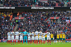 LONDON, ENGLAND - Sunday, March 26, 2017: England players and supporters stand to remember the victims of the Westminster Bridge car crash and stabbing before the 2018 FIFA World Cup Qualifying Group F match against Lithuania at Wembley Stadium. (Pic by David Rawcliffe/Propaganda)