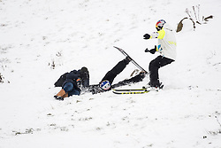 © Licensed to London News Pictures. 01/03/2018. Essex, UK. On day 3 of the Beast Of The East, snowboarders film some stunts at Hadleigh Country Park in Essex. This park was constructed for the 2012 Olympic mountain bike events.. Photo credit : Simon Ford/LNP