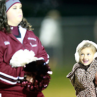Thomas Wells | BUY AT PHOTOS.DJOURNAL.COM<br /> Brookalyn Lockhart joins the Smithville cheeerleaders on the field to form a spirit line for the team on Friday.