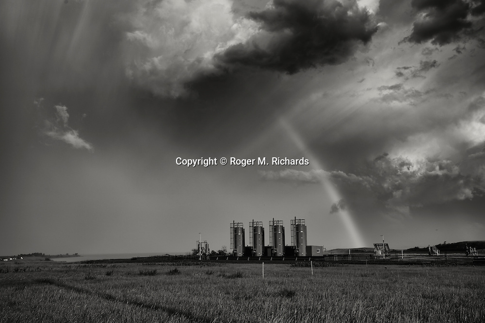A rainbow appears after a tornado passes through an area with oil drilling rigs and storage tanks on the prairie near Williston, North Dakota. The Bakken Shale formation in North Dakota contains some of the richest deposits of oil and gas in the world. This has led to a boom in hydraulic fracturing (fracking) in the state and region, with considerable economic benefits but also negative consequences for residents way of life and environment of the area.
