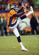 Denver Broncos punter Britton Colquitt (4) punts during the NFL week 19 AFC Divisional Playoff football game against the Indianapolis Colts on Sunday, Jan. 11, 2015 in Denver. The Colts won the game 24-13. ©Paul Anthony Spinelli