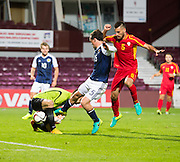Scotland's Liam Henderson nicks the ball away from FYR Macedonia goalkeeper Igor Aleksovski during Scotland Under-21 v FYR Macedonia,  UEFA Under 21 championship qualifier  at Tynecastle, Edinburgh. Photo: David Young<br /> <br />  - &copy; David Young - www.davidyoungphoto.co.uk - email: davidyoungphoto@gmail.com