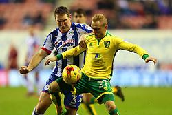Alex Pritchard of Norwich City and Jake Buxton of Wigan Athletic - Mandatory by-line: Matt McNulty/JMP - 07/02/2017 - FOOTBALL - DW Stadium - Wigan, England - Wigan Athletic v Norwich City - Sky Bet Championship