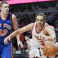 17 December 2009:  Chicago Bulls center Joakim Noah reaches for the ball as New York Knicks center David Lee stares at the referee during the Chicago Bulls 98-89 victory over the New York Knicks at the United Center, in Chicago, Illinois, USA.