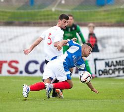 Falkirk's Jonathan Flynn and Cowdenbeath's Kane Hemmings.<br /> Cowdenbeath 1 v 0 Falkirk, 14/9/2013.<br /> &copy;Michael Schofield.