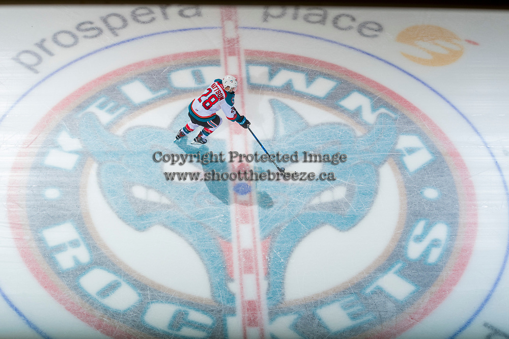 KELOWNA, CANADA - DECEMBER 30: Leif Mattson #28 of the Kelowna Rockets picks up the puck at centre ice during the shoot out against the Victoria Royals on December 30, 2017 at Prospera Place in Kelowna, British Columbia, Canada.  (Photo by Marissa Baecker/Shoot the Breeze)  *** Local Caption ***