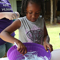 Jatalyia Rainey, 7 makes slime Saturday at the Oren Dunn Museum for Arc in the Park